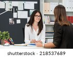 two young businesswomen having... | Shutterstock . vector #218537689