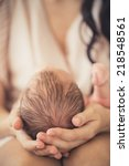 mother holding head of her... | Shutterstock . vector #218548561