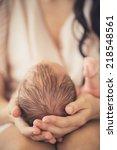 mother holding head of her... | Shutterstock . vector #218548561