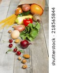 fruits and vegetables rolling... | Shutterstock . vector #218565844