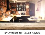 wooden retro desk in kitchen  | Shutterstock . vector #218572201