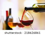 Red Wine Pouring Into Wine - Fine Art prints