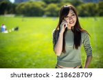 young asian woman in a park... | Shutterstock . vector #218628709