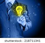 business man touching light of... | Shutterstock . vector #218711341