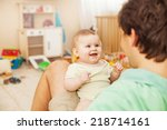 father with his cheerful baby | Shutterstock . vector #218714161