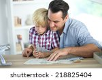 father and kid making a plane... | Shutterstock . vector #218825404