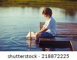 A Cute Little Boy Sitting On...