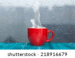 Steaming Coffee Cup On A Rainy...