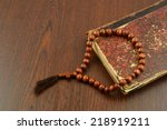 the holy bible and rosary beads ... | Shutterstock . vector #218919211
