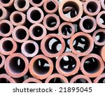 Stack of ceramic pipes of different size. - stock photo