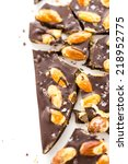 Small photo of Gourmet almighty almond chocolate bar with sea salt on a white background.