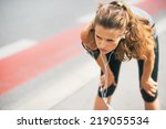 portrait of tired fitness young ... | Shutterstock . vector #219055534