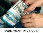 Woman Hiding Money In Sock...
