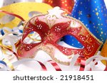 Closeup shot of Venetian mask, party hats and streamers - stock photo