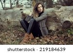 Young Girl Sitting Outdoor In...