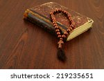the holy bible and rosary beads ... | Shutterstock . vector #219235651