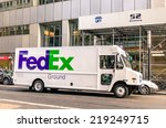 "Small photo of NEW YORK CITY - NOVEMBER 21, 2013: FedEx van delivering in downtown Manhattan. The name ""FedEx"" is the short version of the company original air division, Federal Express, which was used until 2000."
