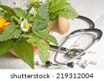 fresh herb and stethoscope... | Shutterstock . vector #219312004