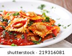 ravioli with tomato sauce | Shutterstock . vector #219316081