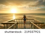 Woman On Balcony Looking At Th...