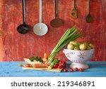 vegetables and kitchen utensils ...