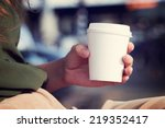 young woman drinking coffee... | Shutterstock . vector #219352417