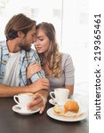happy couple enjoying a coffee... | Shutterstock . vector #219365461