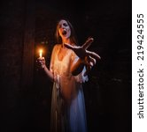 scary woman standing in a dark... | Shutterstock . vector #219424555