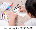 woman hand writing a graph | Shutterstock . vector #219493627
