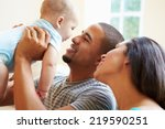 young family playing with happy ... | Shutterstock . vector #219590251