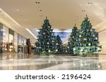 Shopping mall interior decorated with christmas trees - stock photo