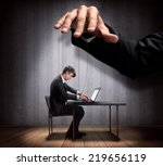 businessman's hand controlling... | Shutterstock . vector #219656119