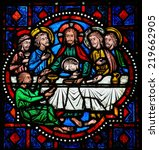 TOURS, FRANCE - AUGUST 8, 2014: Stained glass window depicting Jesus and the Apostles at the Last Supper on Maundy Thursday in the Cathedral of Tours, France. - stock photo