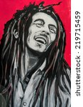 Small photo of SETE, FRANCE - SEPTEMBER 21, 2014: Graffiti portrait of Bob Marley, a famous Jamaican reggae singer-songwriter and guitarist on the wall of Sete, south of France.