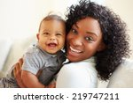 smiling mother playing with... | Shutterstock . vector #219747211