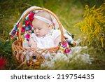 cute little baby in basket  | Shutterstock . vector #219754435