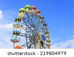 Ferris Wheel On The Background...
