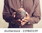 Newborn Cradled In His Father'...