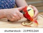 Hands Peeling A Cooking Apple...