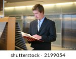 a business man doing research... | Shutterstock . vector #2199054