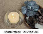 Potpourri And Candle On Burlap...