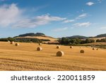 hay bales on fields in the...