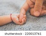 new born baby hand | Shutterstock . vector #220013761