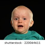 portrait of a crying blond baby ... | Shutterstock . vector #220064611