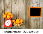 tangerines on scales on a... | Shutterstock . vector #220125019