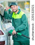Smiling Worker At The Gas...