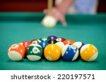 Young Man Playing Billiards In...