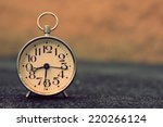Stock photo retro alarm clock with retro vintage efect 220266124