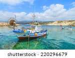 Fishing Boats In A Port In...