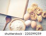 the tagliatelle pasta with cookbook - stock photo